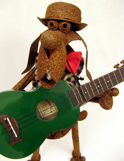 Rusty the Dog with a green ukulele